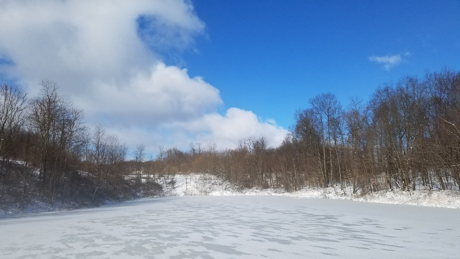 Taken when we had winter storm Harper in Western PA.  I love how the pond looks like it is never ...