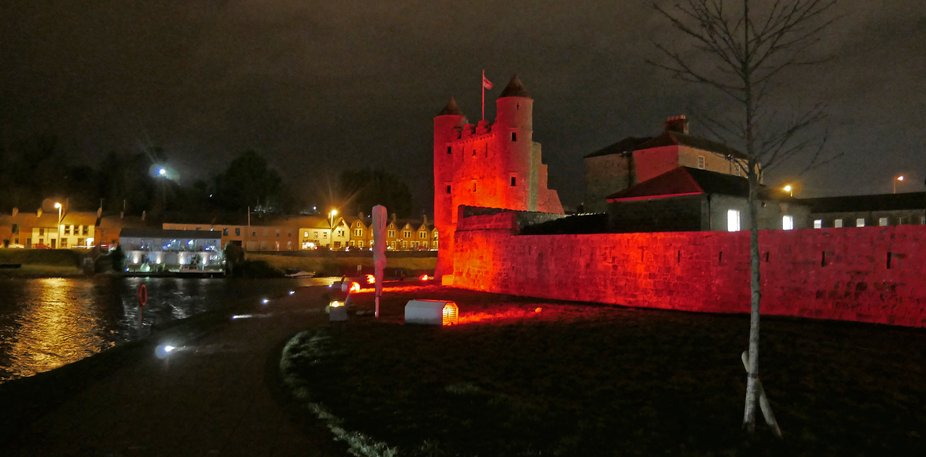 Enniskillen's historic castle lit up in red to celebrate the centenary of the founding o...