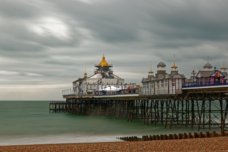 Eastbourne Pier, central to the seafront with its best surviving ironwork and little kiosks of th...