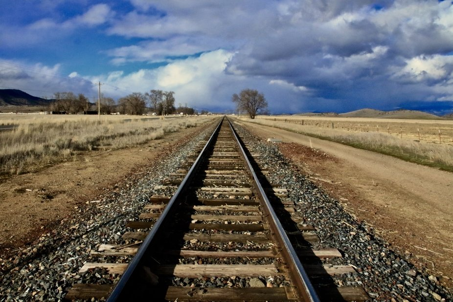 Shot from middle of railroad tracks looking to where the dramatic winter storm was coming from. L...