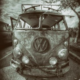 "Image captured at a car show dedicated to Volkswagen's of an old VW bus with vintage Florida license plates with the iconic ""Arrive Ali..."