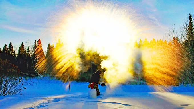 Tossing water in the air at 40 below zero. taken into the rising sun in the back yard.  lightened and highlighted vivid