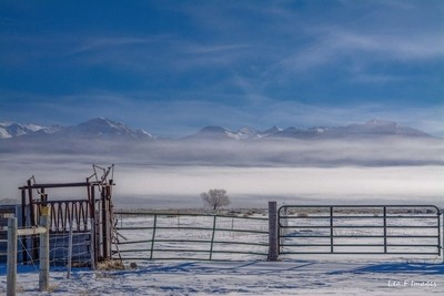 Cold morning view of the Sangre De Cristo Mountains shrouded in fog
