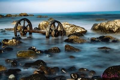 Old Wagon Wheels in the Sea.