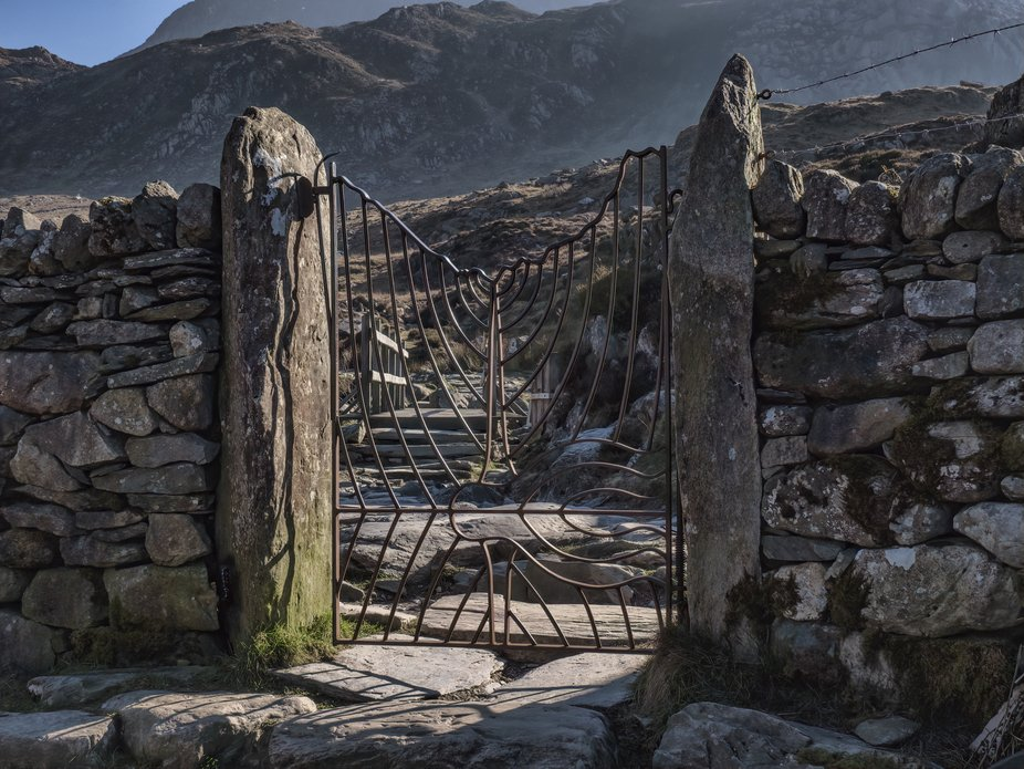 This ornate gate was designed by Joe Roberts, one of the National Park Seasonal Wardens, as a tri...
