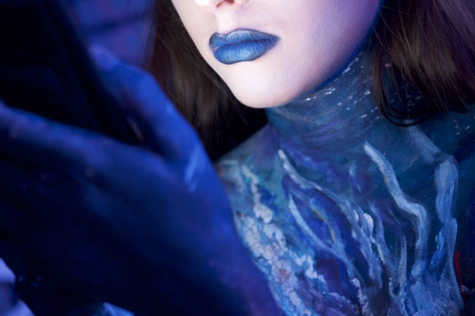 Closeup young woman, body art, blue lips