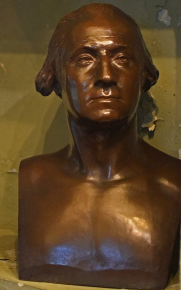 George Washington bust in crumbling corner of his ancestral home Washington Old Hall UK.