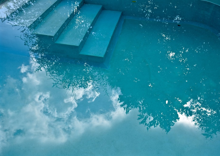 While sunning I noticed in the still, pool water the beautiful reflection of the sky before the u...