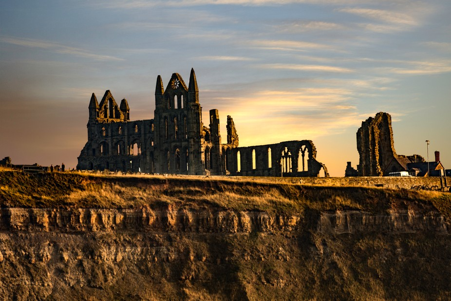 The ruins of Whitby Abbey situated behind Whitby Church on the cliff top overlooking Whitby Harbo...