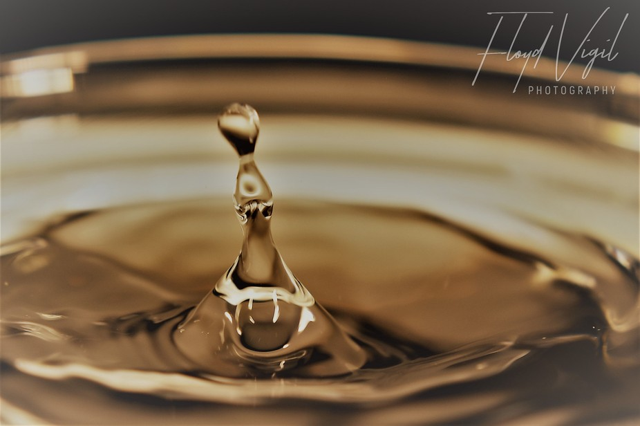 Simple drop of water into water
