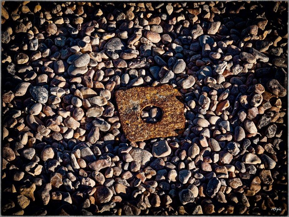 metal plate rusting on the beach.