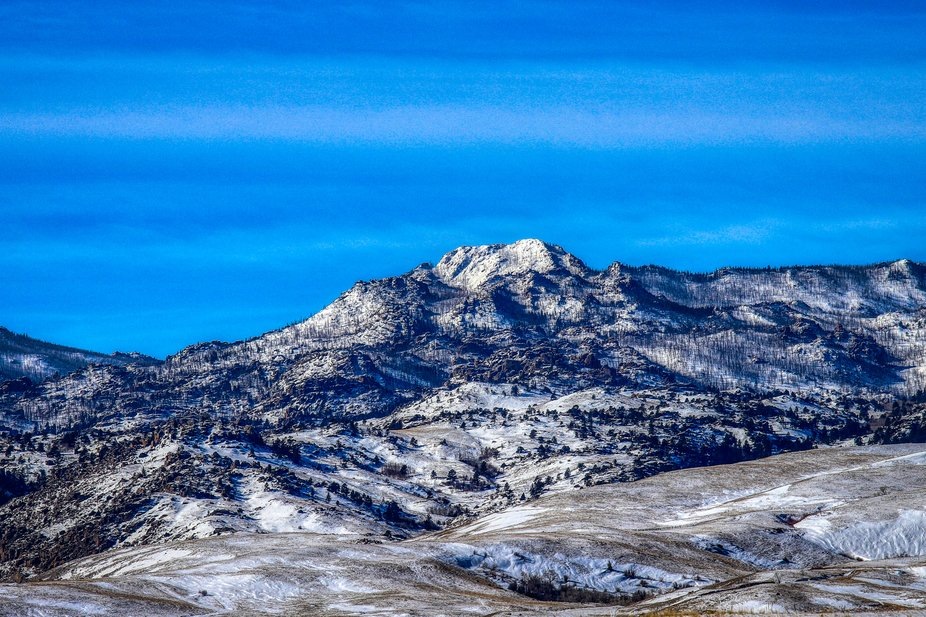 This is a landscape photo of a scenic snow-capped mountain just outside of Douglas, Wyoming.