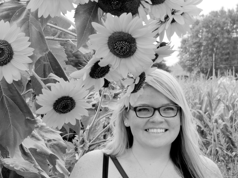 my youngest daughter enjoying the sunflower garden in Sanborn NY.