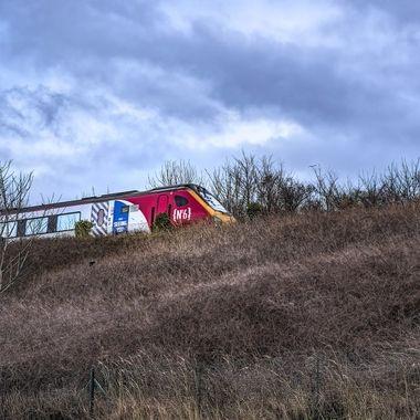 A fast train startles a bird at Colwyn Bay