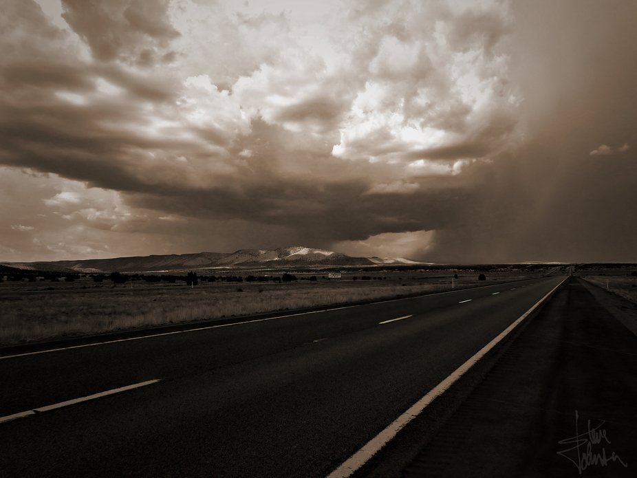 Eastbound, Highway 40, a cloudburst looms up ahead. Better put the top up!