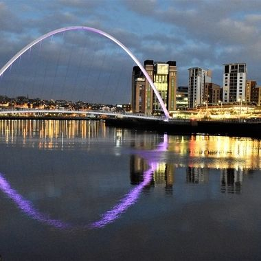 City Scene on the Quayside Newcastle reflecting the Arc of the bridge.