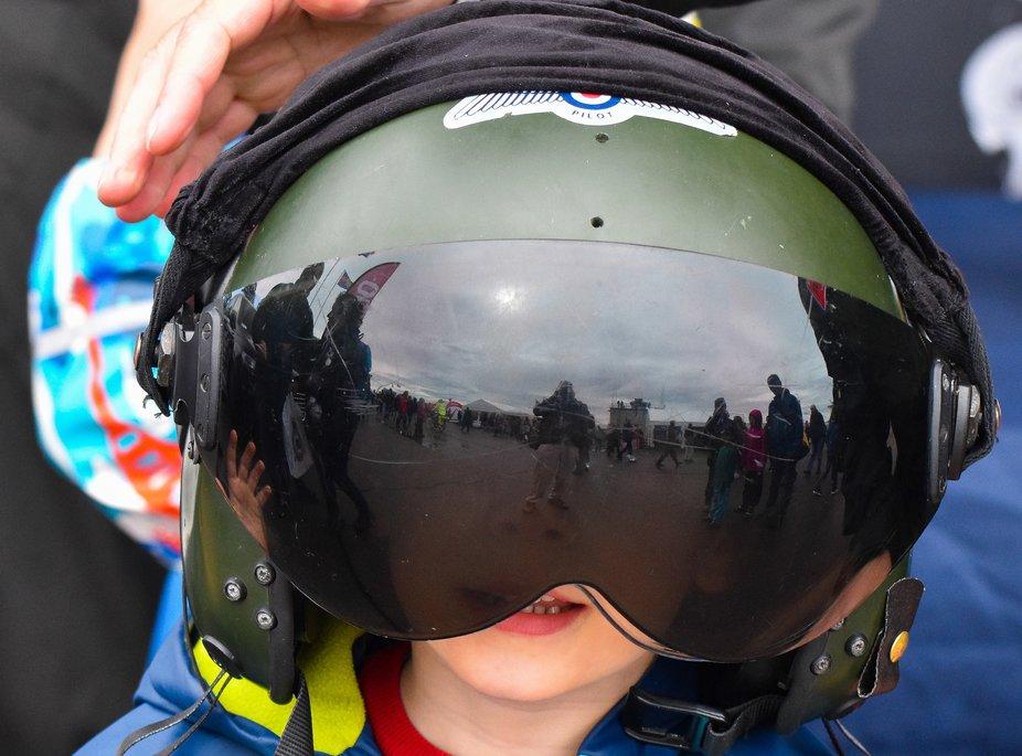 BoB RAF 100 celebrations at Duxford, my grandson sporting a fighter pilots helmet