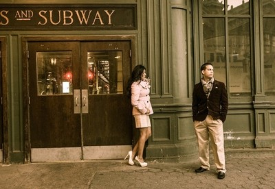Early morning portrait of a young couple at the Hoboken Train Station.