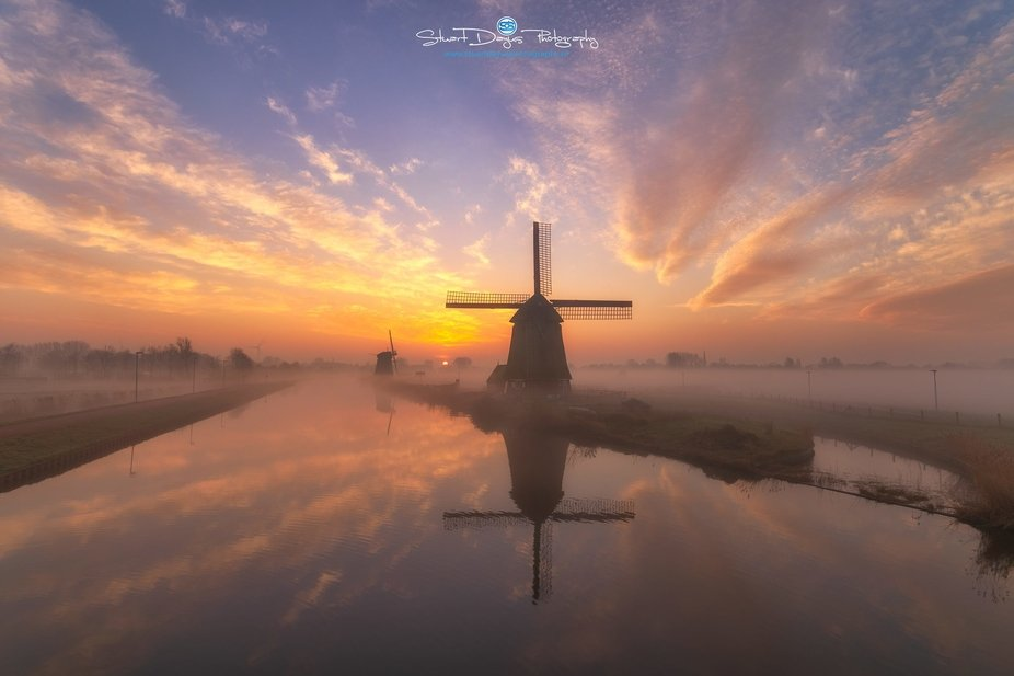 Beautiful conditions at a local waterway. The sun just rising over the horizon and a mist creatin...