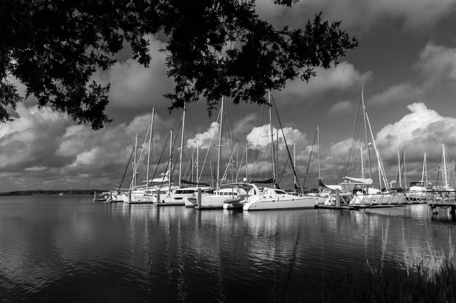 Sailboats docked at the local marina under stormy clouds.