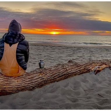 Mourning Sunrise  I asked this young man if I could take a picture of him watching the sunrise this morning which he graciously accepted. I thought he was drinking coffee but I noticed he had an urn next to him and he explained that his son died a year ago