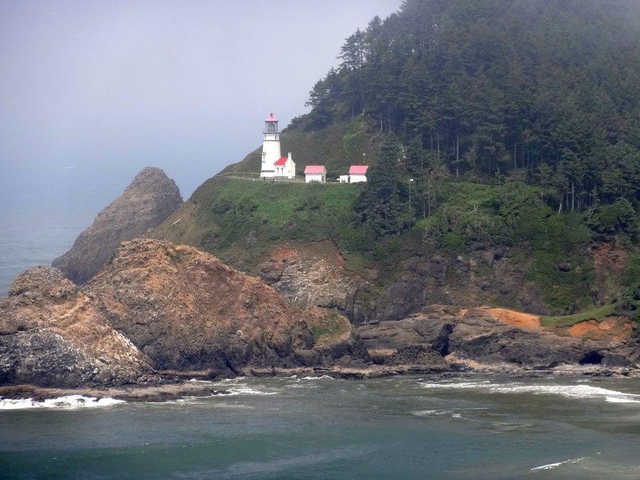 On a foggy day, a lighthouse on the Oregon Coast, USA