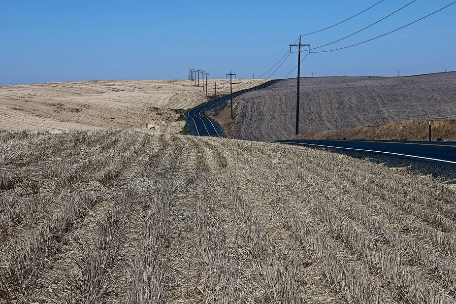 The highway was recently paved.  Stubble shows it's after harvest time in the Palouse in...