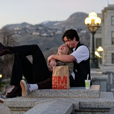 This couple was enjoying the sunset and what appears to be a very happy meal at the Utah State Capitol.