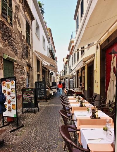The old narrow street Santa Maria, and its outdoor restaurants