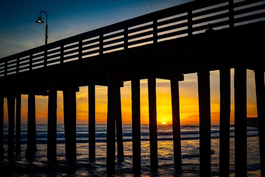 Watching the sunset through the underside of Cayucos Pier