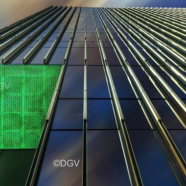 Green soffit and reflection of building looking up