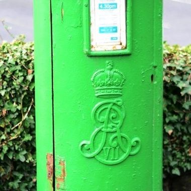 Traditional pillar post box from the late 19th century, originally red, these were painted green following independence in the 1920s.