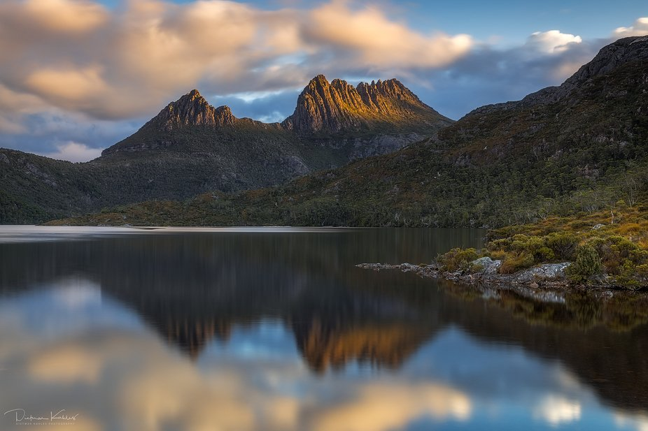 A classic reflection view of Tasmania's iconic Cradle Mountain. The late afternoon light...