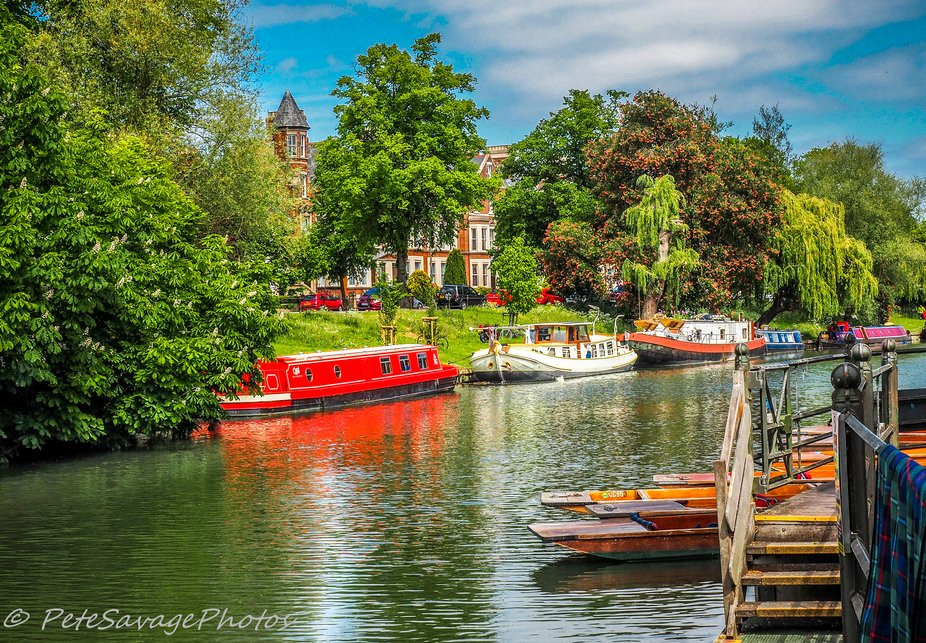 Beatiful setting on the Cam River in Cambridge, UK.  River punts moored ready to explore the exte...
