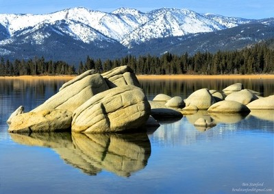The ski area of Mount Rose was covered in snow. But, at lake level the air was still and calm allowing the mirrow like reflections from the ancient and well worn exposed rocks.