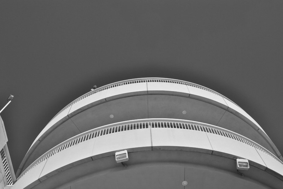 A man looks down at me as I photograph the San Diego Convention Center from below.