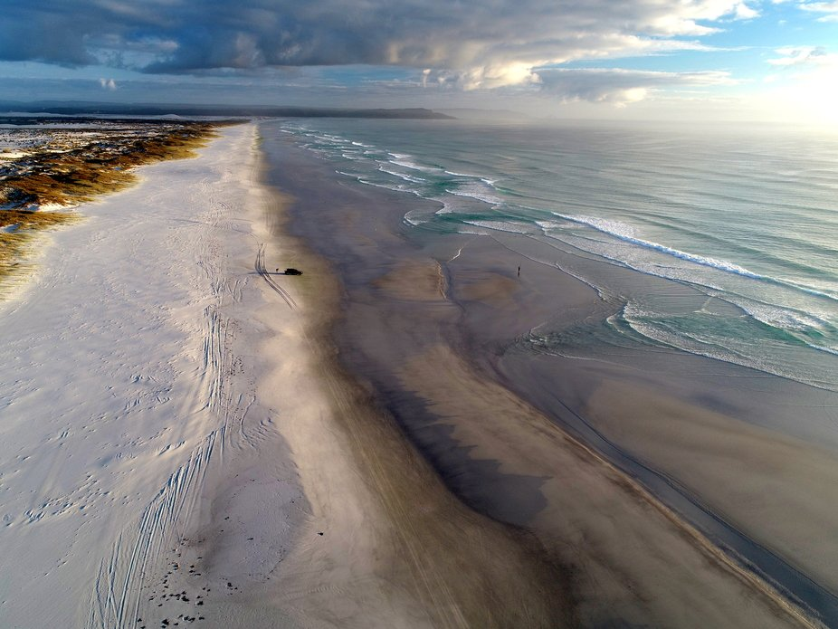 Drone shot of fishermen on Great Exhibition Bay in the Far North of New Zealand. A lonely beautif...