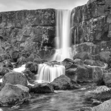 This waterfall is located in Thingvellir National Park, Iceland.
