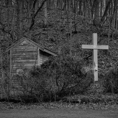 Hut and cross in black and white