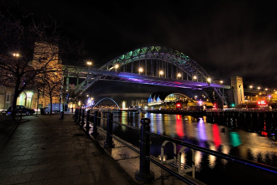 A shot of the Tyne bridge from the quayside, looking towards gateshead with the sage in the backg...