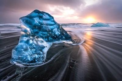 Iceberg on Diamond Beach in Iceland during sunrise