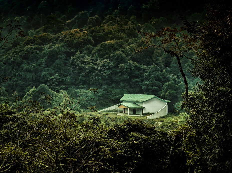 the lonely house in the slope of Himalayas