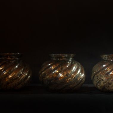 Three vases with light from the right, low key
