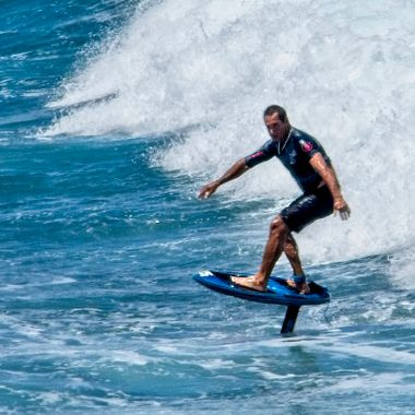 A Maui north shore surfer using a hydrofoil board.