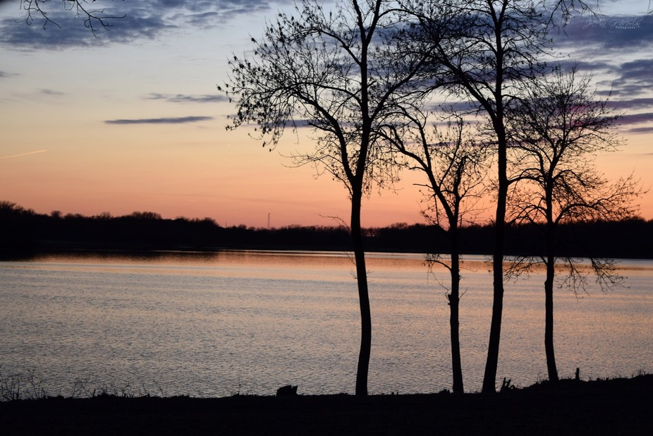 Spring 2019 sunset on the lake nearby our home.  Trees are budding.  Ice has thawed.