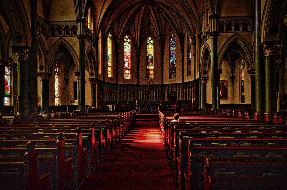 A shaft of sunlight illumines a quiet moment of solitude in an empty church.