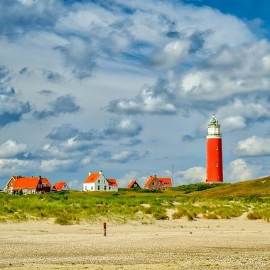 Lighthouse with houses at Texel,Holland on a bright September day 2018