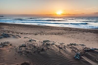 The sun rising over the seas