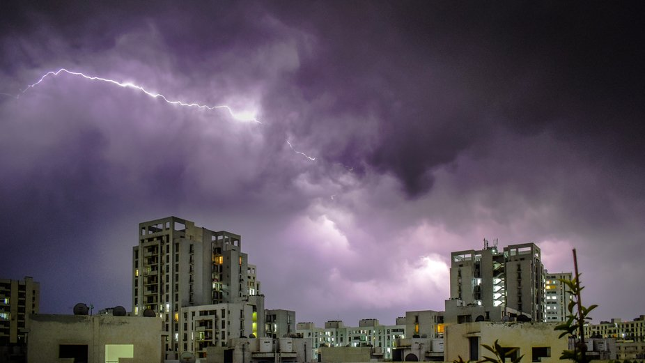Lightning and Sand Storm after a sizzling hot day.