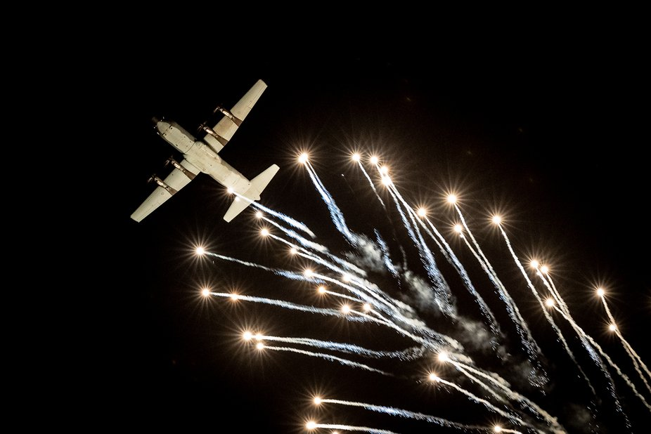A flare drop performed by the RAAF's C130J Hercules ends the Friday Night Alight display at the Australian International Airshow